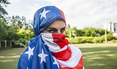 A Muslim woman wearing a headscarf made of the United States' flag.